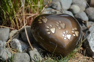 Brass heart shaped urn for dogs